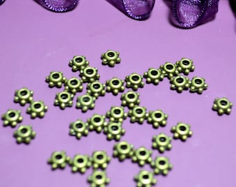 Set of 10 spacer beads colored bronze star 05mm