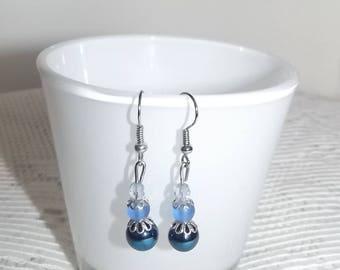 Blue stud earrings.
