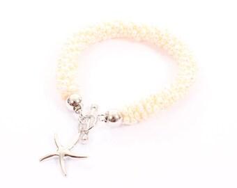 Freshwater white pearl multi strand bracelet   925 sterling silver