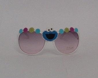 Kid Child size COOKIE MONSTER inspired Sesame Street white frame uv sunglasses novelty costume Muppet Henson fun silly cookies blue