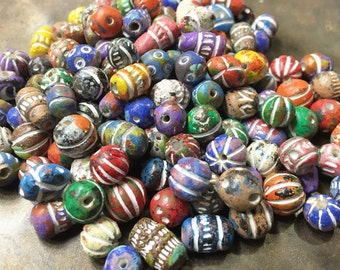 26 grams Small Craved Clay Beads. Hand painted colorful to neutral tones. 14 inches about 26 grams. 5mm to 12mm stringing length