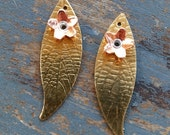 PAIR of dainty leaves wit...