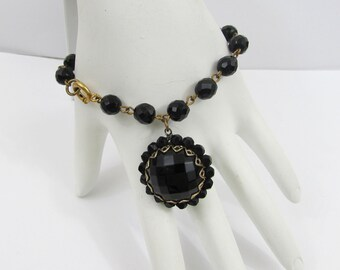 "Black Faceted Glass Bracelet - 6.75"" Linked bracelet with 1"" domed dangle - 50s-60s"
