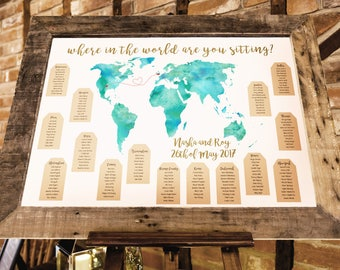 World map travel themed wedding seating plan made and personalised with couples locations