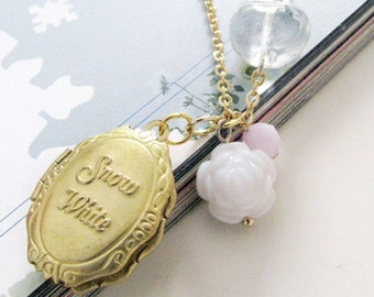 Snow White locket necklace. Gold locket with clear quartz apple and white rose bead