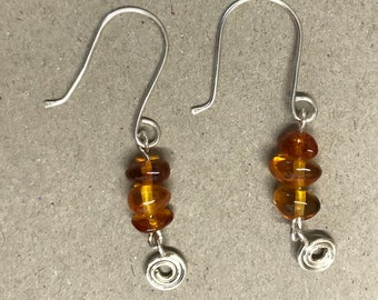 Silver spiral and amber bead earrings