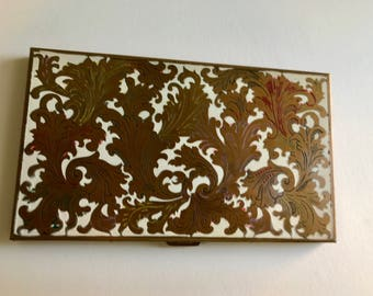 Vintage Volupte compact; enameled brass with florentine scrollwork. Circa 1940s