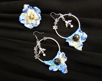 """Dramatic earrings * soft flowers"""