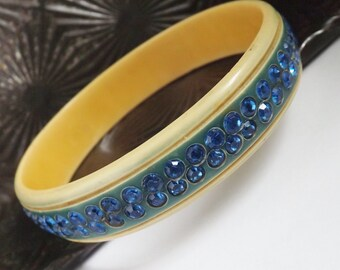 Vintage Art Deco carved celluloid rhinestone bracelet or bangle blue stones striped on ivory cream painted