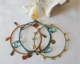 Multi Colored Trio of Bangle Bracelets with Charms