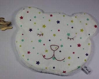 Cute cuddly teddy, multicolored stars.