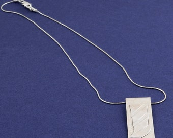 pure silver necklace with pendant with texture d application.