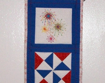 Fireworks Americana small quilted wall hanging, wire hanger included