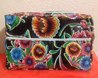 Lined Oilcloth Cosmetic Bag in Black and flowers