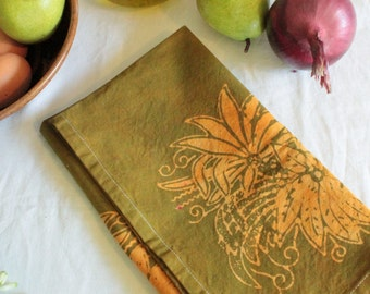 gold and green batik tea towel
