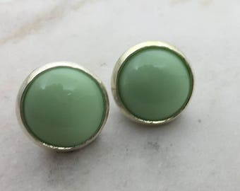Pale green resin stud earrings. 14mm with surgical steel and nickel free posts.
