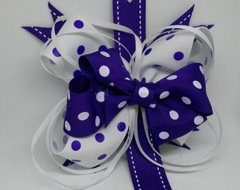 Purple and white polka dot boutique bow