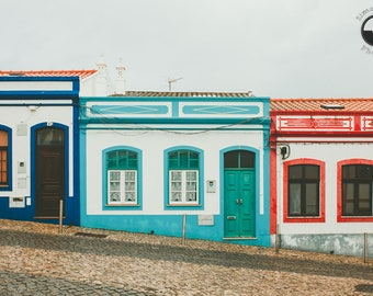 Turquoise blue, red and white colored houses, Lagos Portugal