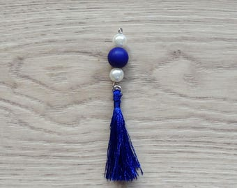 Pendant beads and blue tassel
