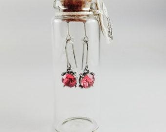Swarovski deep pink drop earrings in gift bottle