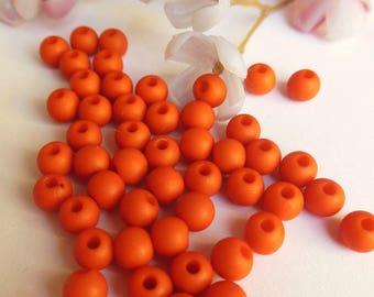 set of 50 plastic round beads-orange