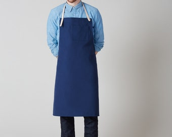 """Dahls"""" blue canvas apron. Leather straps. Handmade in Montreal, Canada"""