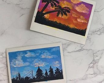 handmade sky paintings on polaroid film