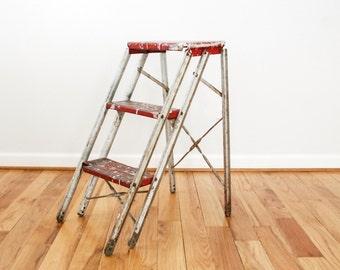 metal ladder, step ladder, ladder shelf, red metal folding step ladder, great rustic industrial character, 3 steps, vintage