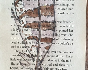 Upcycled watercolor painting of hawk feather on recycled book page Reuse Repurpose Mixed media Little house on the Prairie