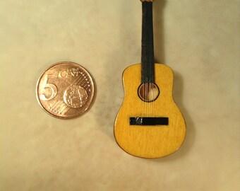 Miniature guitar made of basswood.