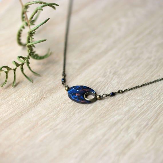 Short, black necklace with a dark blue, oval, handmade pendant 'Nelumbo', vegetal patterns, brass necklace, minimal design