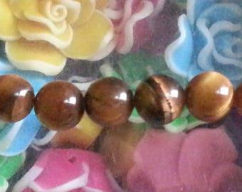 1 bead 8 mm in diameter, hole 1 mm Tiger eye