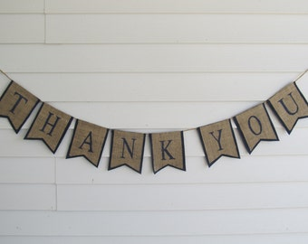 """Rustic Burlap """"Thank You"""" Wedding Banner Shown with Navy Blue Lettering and Outline"""