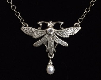 Sterling silver cast dragonfly with freshwater pearl and CZ.