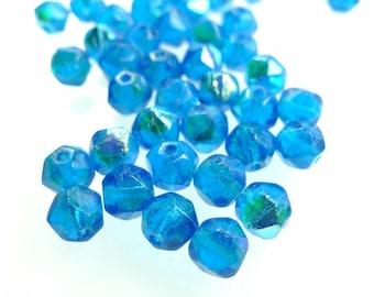 Rough cut, glass beads dk aqua AB