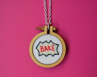 """Embroidered necklace of """"bake"""" in comic book style"""