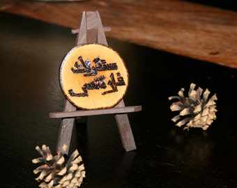 SOLDArabic calligraphy on wood branch Wood burning