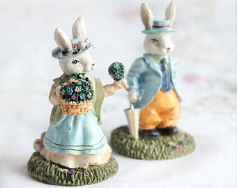 Mr Mrs Easter bunnies_Easter bunny figurines_set of two_1970s_Easter rabbits statuettes_fine art ceramics_white green blue_yellow ivory red