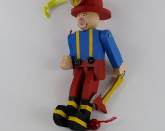 Saluting Fireman wooden ornament