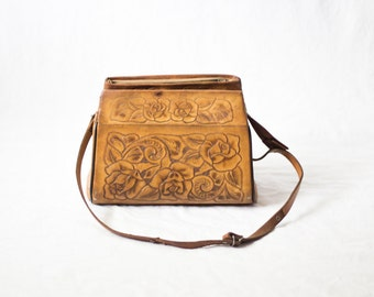 tooled leather 1920s doctor bag with floral embellishments