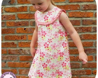 Bia's A line dress PDF sewign pattern for beginner to intermediate sewers, rounded yoke w/pleats, closes w/packet and buttons, 1 to 8 yrs