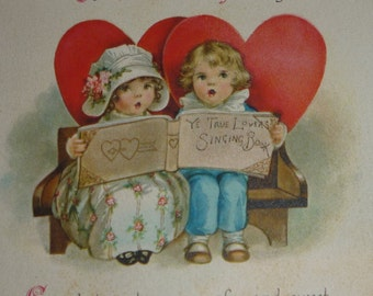 Ellen Clapsaddle Boy and Girl With Hearts and Singing Book  Vintage Valentine Card