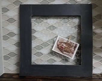 Black frame. Chicken wire frame. Picture frame.