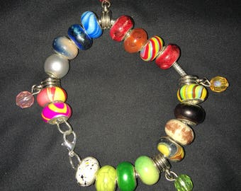 Colorful bead bracelet with charms