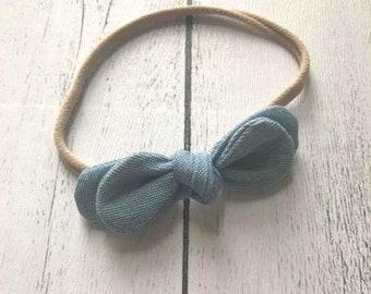 Double Knot fabric headband on nylon band