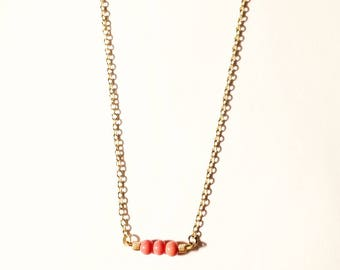 Coral and gold beaded pendant bar necklace