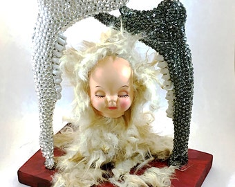Bone sculpture, found object art, real animal bone and fur, vintage doll parts