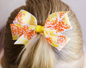 Hair Bow - Orange and Yellow on White Damask Print Pinwheel Bow