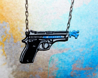 Anti Gun BE PEACEFUL  Water Gun Necklace by beebles