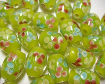Yellow-green oval floral lampwork glass beads